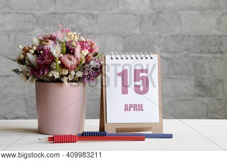 April 15. 15-th Day Of The Month, Calendar Date.a Delicate Bouquet Of Flowers In A Pink Vase, Two Pe