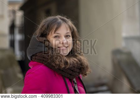 Close-up Of A Street Portrait Of A Cheerful, Successful Middle-aged Woman With Delicate Features. A