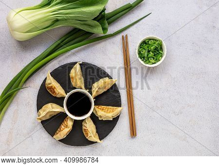 Vegan-friendly Japanese Pan-fried Dumplings Gyoza With Cabbage, Carrot, And Onion. Copy Space, Top V