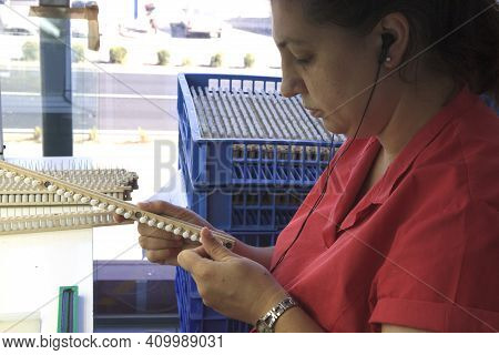Manacor ( Mallorca ), Spain - August 10, 2016: A Woman Work In A Factory Shop In Manacor Where Are M