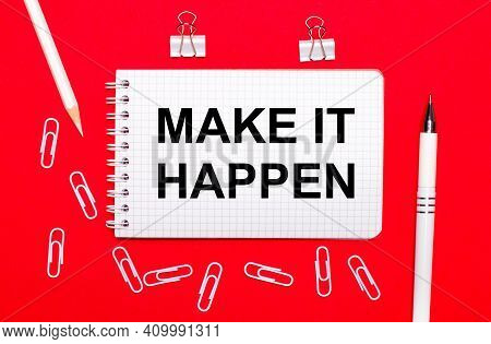 On A Red Background, A White Pen, White Paper Clips, A White Pencil And A Notebook With The Text Mak