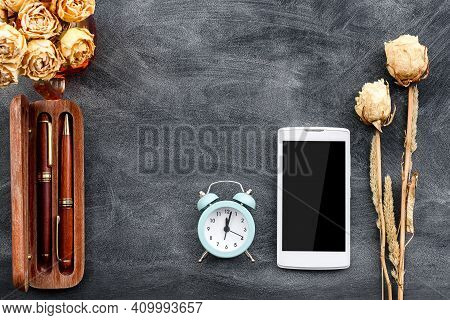 Fashionable Stationery Background On Black-smartphone, Parker Pens And Dried Flowers.