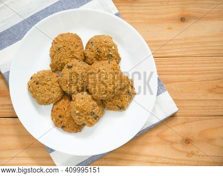 Oatmeal Cookies With Raisin On Wooden Table For Breakfast