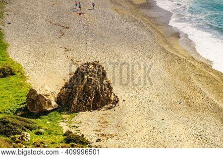 People On Sandy Beach Sea Shore, Rocky Shoreline, Andalucia Spain.