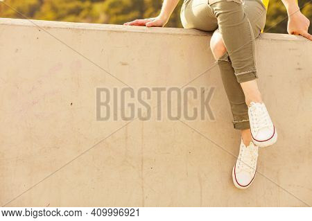Trendy Fashionable Unrecognizable Female Relaxing Outdoor Wearing Casual Footwear White Sneakers And