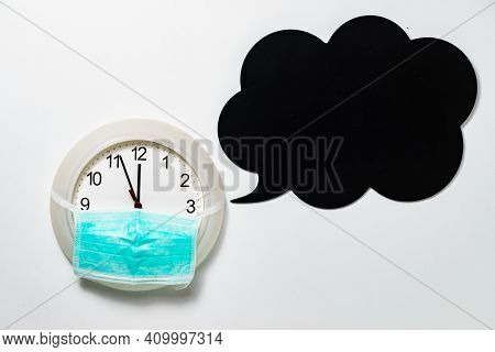Wall Clock With Face Protective Mask Ticking Showing 12 Hours. Time Deadline, Corona Virus Preventio