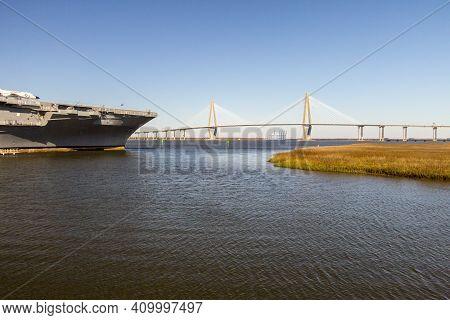 Mount Pleaseant, South Carolina, Usa -february 21, 2021: The Uss Yorktown And Ravenel Bridge At Patr