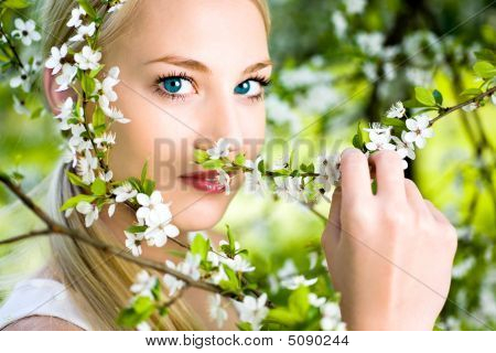 Woman By Flowers On Tree
