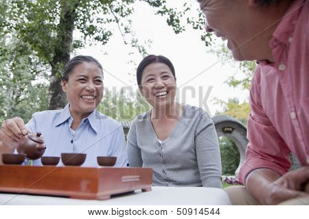 Group of mature people drinking Chinese tea in the park