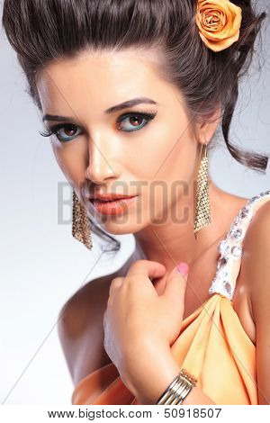 closeup portrait of young fashion woman looking into the camera. on gray background