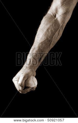 man's arm squeezing tennis ball