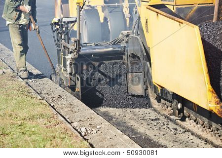 asphalt paver machine during urban road construction and repairing works
