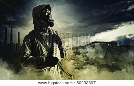 Stalker against nuclear background. Disaster and pollution poster