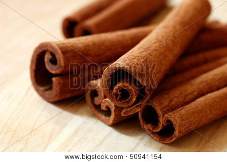 Cinnamon sticks on wood background.  Macro with extremely shallow dof.