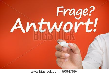 Hand writing Frage and Antwort with a marker on red background