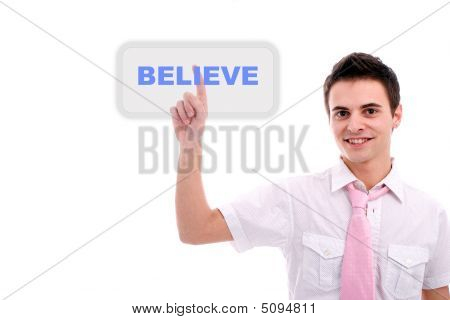 Young Business Man Pressing The Believe Key