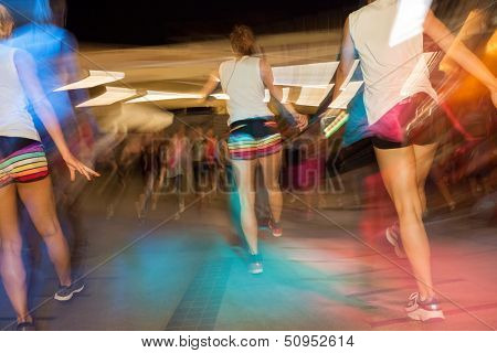 Young active people dancing in gym, fitness dance class