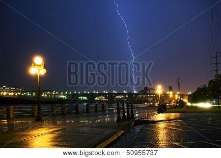 Lightning strike over the Mississippi river and bridges, downtown. Saint Paul, Minnesota