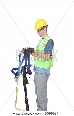 Man Putting On Climbing Harness