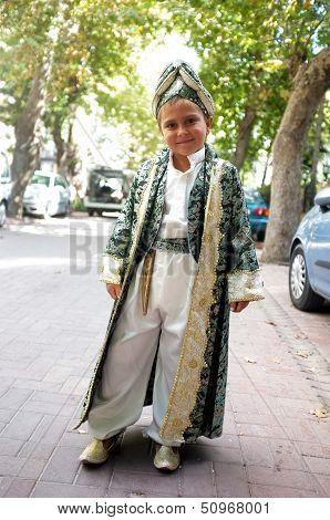 Boy in circumcision dress