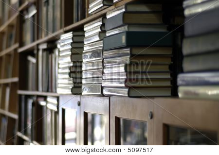 Bookshelves Piled With Books