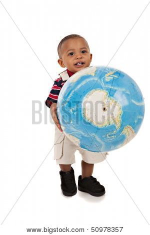 Smiling 1-year old baby boy standing Full Body Length Portrait holding globe on isolated background