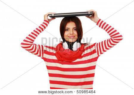 Smiling teen girl holding laptop on top of her head isolated poster