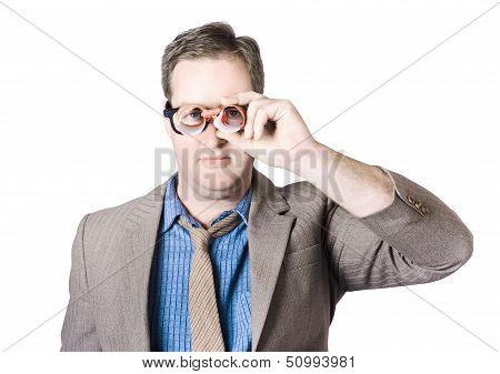 Businessman Looking Through Paper Binoculars
