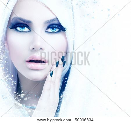 Winter Woman Portrait. Snow. Beauty Fashion Model Girl with White Hair and Blue Eyes closeup. Make up. Smoky Eyes. Isolated on a White Background