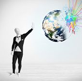 Funny man in body suit looking at colorful splatter 3d earth, Elements of this image furnished by NASA poster
