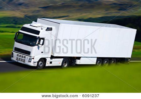 White Semi Truck At Campain