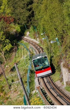 Red Carriage of the Funicular Railway in Bergen Norway climbing Mount Floyen. poster