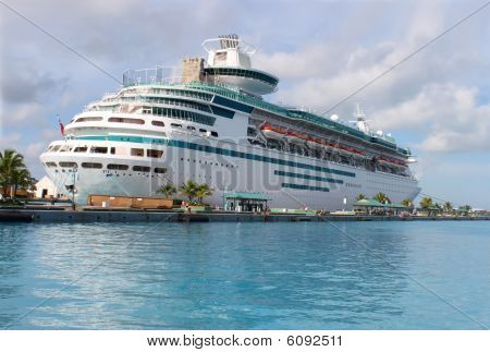 Cruise ship in the clear blue Caribbean ocean docked in the port of Nassau Bahamas poster