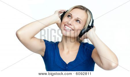 Happy Woman Listening To Music With Headphones On