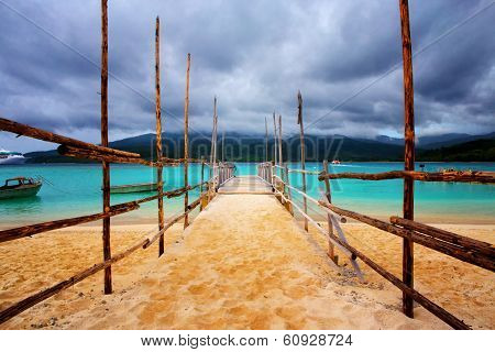 Old wooden jetty on a beautiful tropical beach