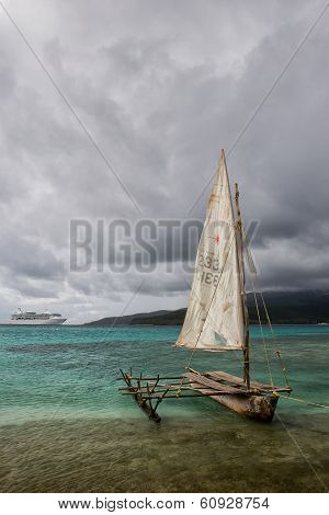 Traditional outrigger canoe and cruise ship