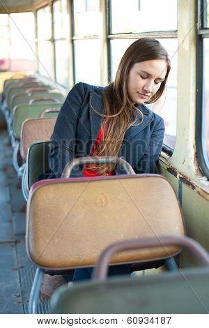 Sleepy Woman Resting In Vintage Bus