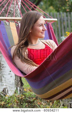 Cheerful Woman Enjoying Summer In Hammock