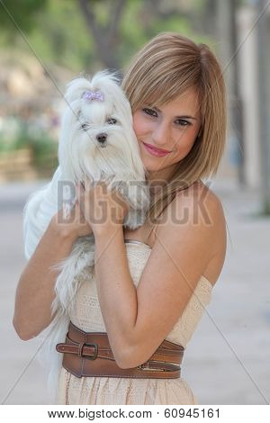 young woman with pet Maltese dog