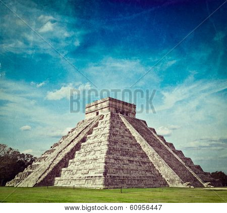 Vintage retro hipster style travel image of travel Mexico background - Anicent Maya mayan pyramid El Castillo (Kukulkan) in Chichen-Itza, Mexico with grunge texture overlaid