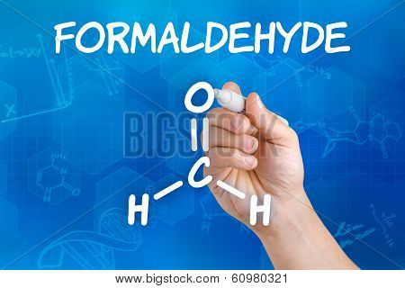 Hand with pen drawing the chemical formula of formaldehyde
