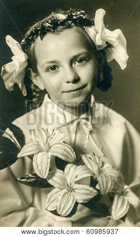 OSTROW, POLAND, SEVENTIES - Vintage photo of little girl at her First Communion