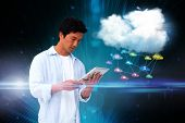 Digital composite of casual man using tablet with app icons and cloud poster