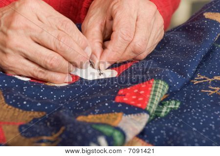 Sewing Santa's Eyes