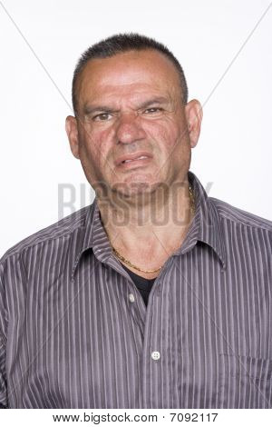 Portrait Of Mid Adult Male With Repugnant Expression. Isolated.