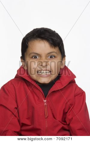 Portrait Of Young Boy With Scary Expression. Isolated.