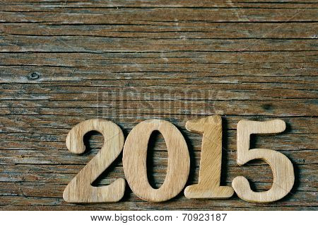 wooden numbers forming 2015, as the new year, on a rustic wooden suface