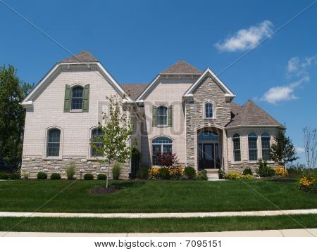 One Story Stucco Residential Home With Clay Tile Roof