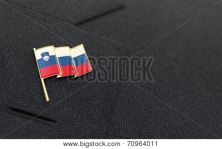 Slovenia Flag Lapel Pin On The Collar Of A Business Suit