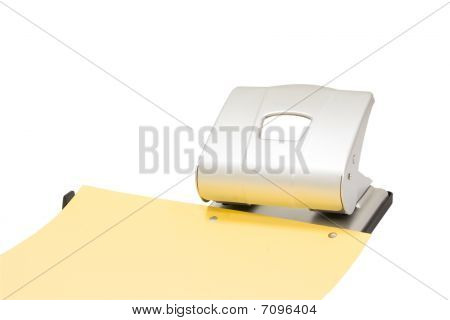 Hole Puncher At Work Isolated